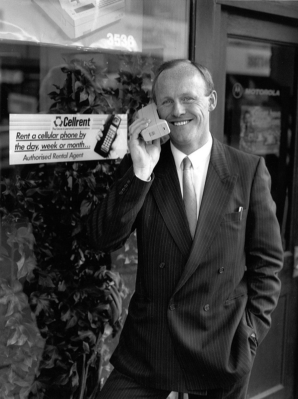 John Caudwell with one of the first mobile phones - A Motorola