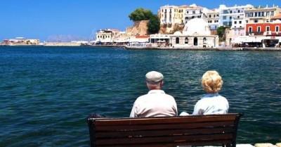 senior-couple-sitting-on-bench-in-mediterranean-area_573x300