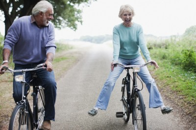 Older couple having fun whilst cycling